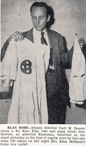 Deason holding Klan robe