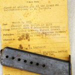 Image of ammunition magazine and evidence envelope