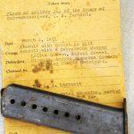 Image of ammunition magazine and evidence envelope
