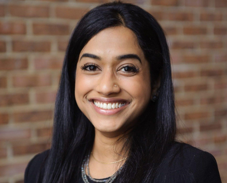 Professor Deepa Das Acevedo poses for a headshot photo.