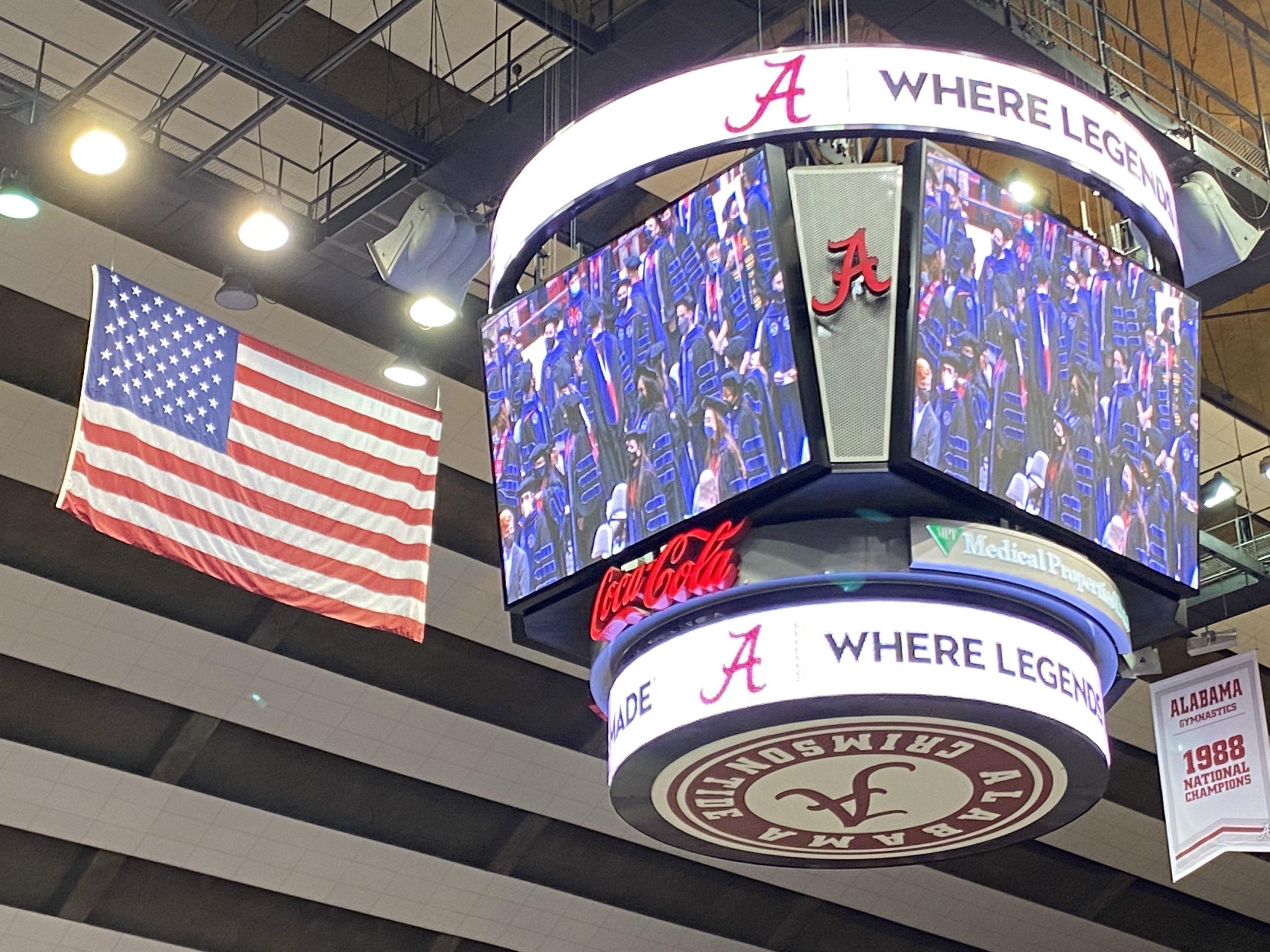 2021 & 2020 Alabama Law Graduates appear on the Jumbotron at Coleman Coliseum.