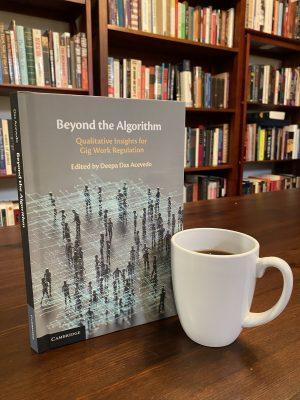Image of Beyond the Algorithm book sitting next to coffee mug