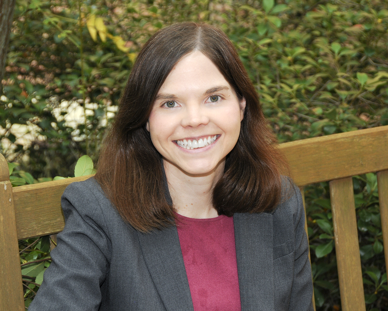 Professor Tara Leigh Grove poses for a photo outside.