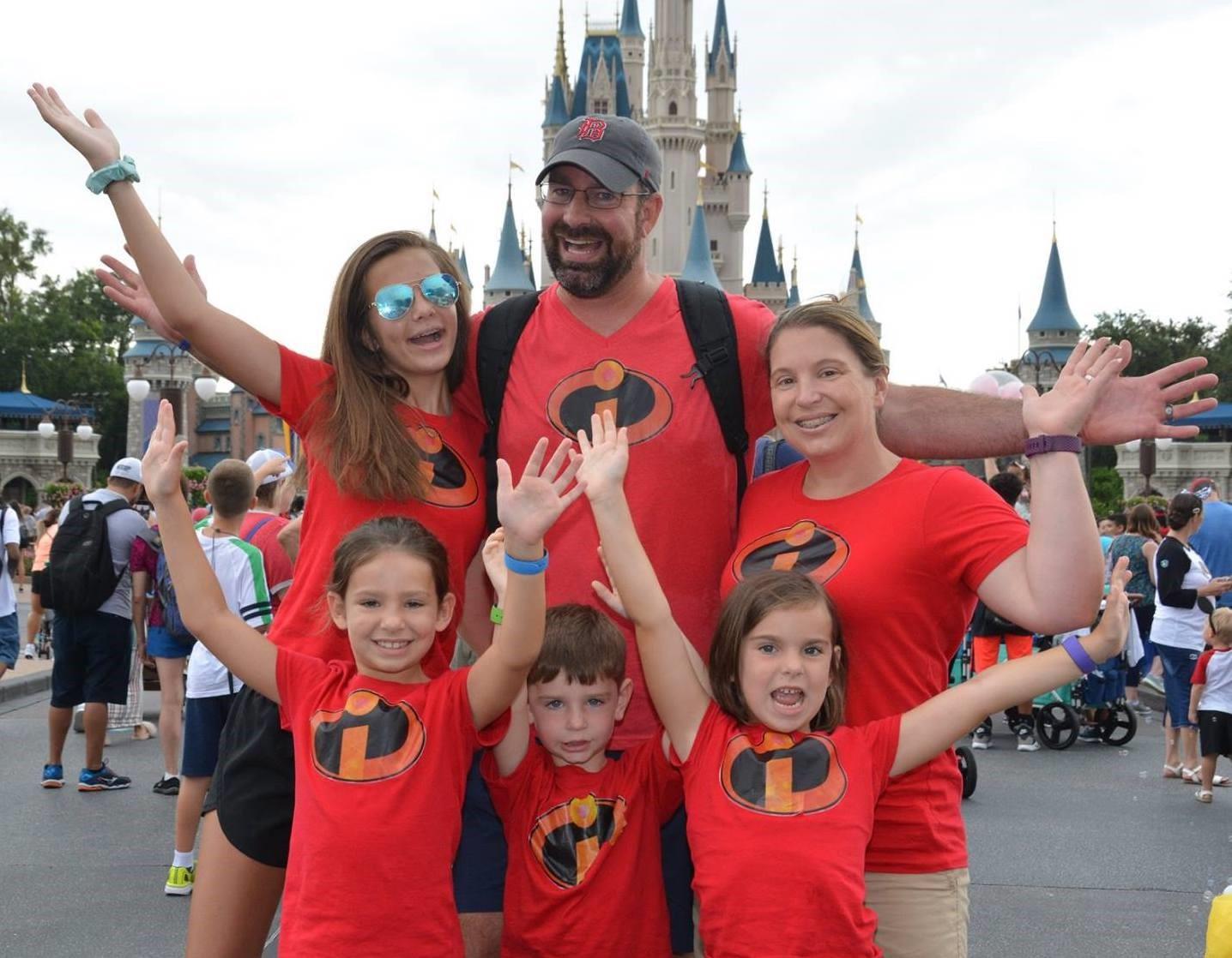 Scott, Beth, and their four children in Magic Kingdom