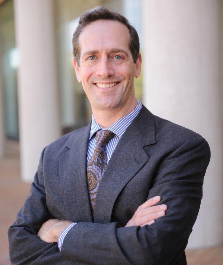Professor Adam Steinman standing in front of The University of Alabama School of Law.