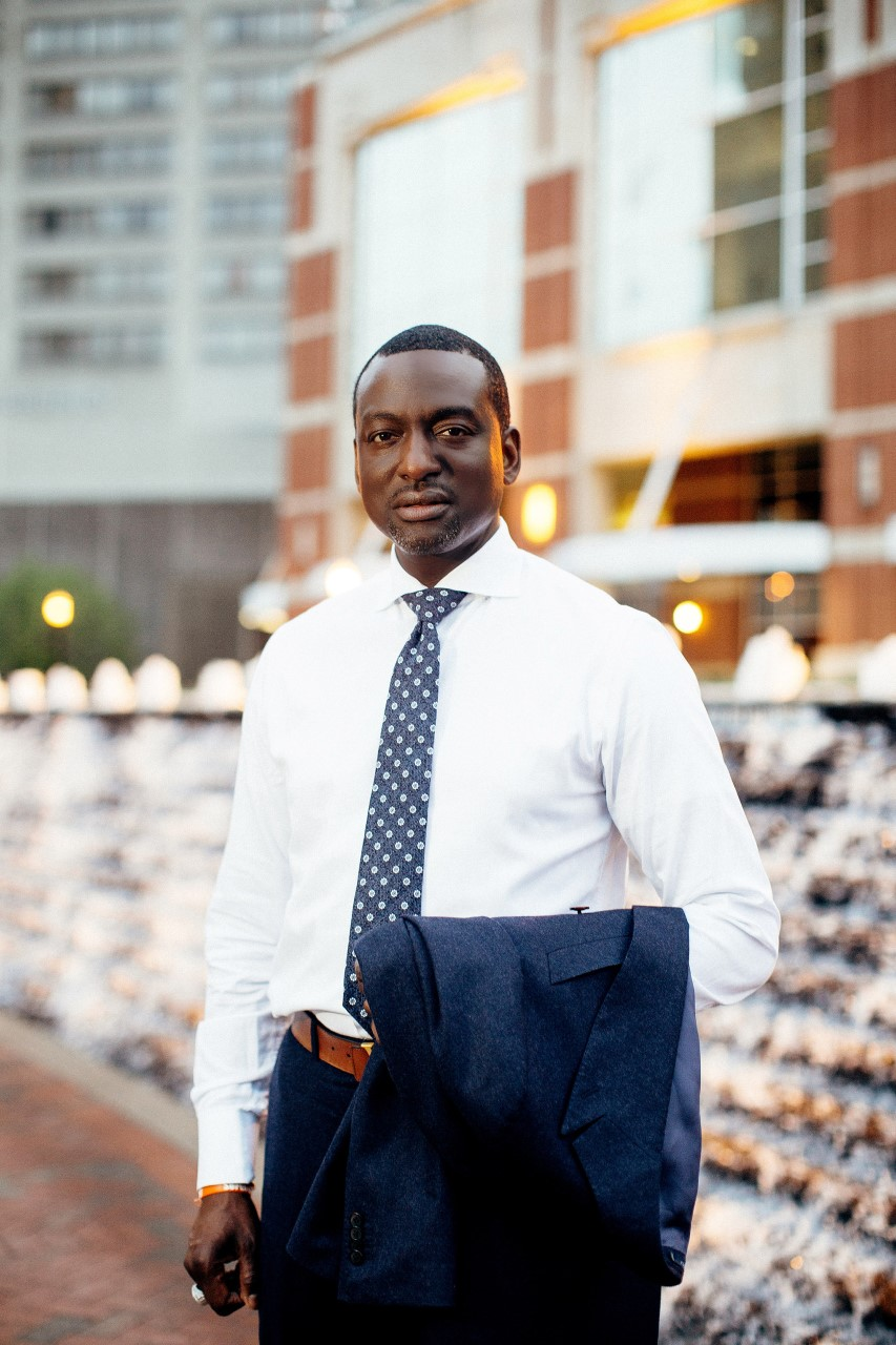 Yusef Salaam standing in front of a building